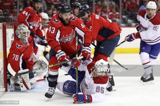 Andrew Shaw of the Montreal Canadiens battles Tom Wilson of the Washington Capitals for the puck during the first period at Capital One Arena on...