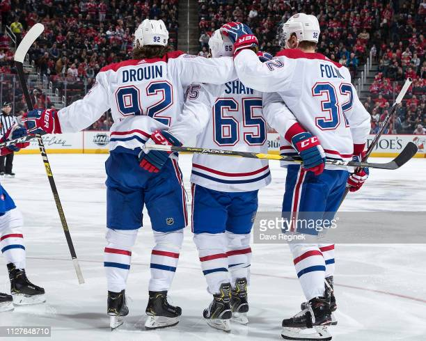 Andrew Shaw of the Montreal Canadiens celebrates his second period goal with teammates Jonathan Drouin and Christian Folin during an NHL game against...