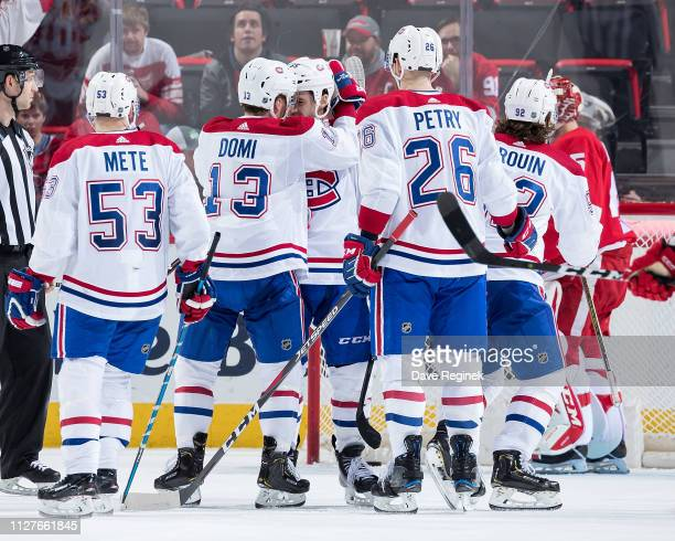 Andrew Shaw of the Montreal Canadiens celebrates his third goal of the game with teammates Victor Mete Max Domi Jeff Petry and Jonathan Drouin in...