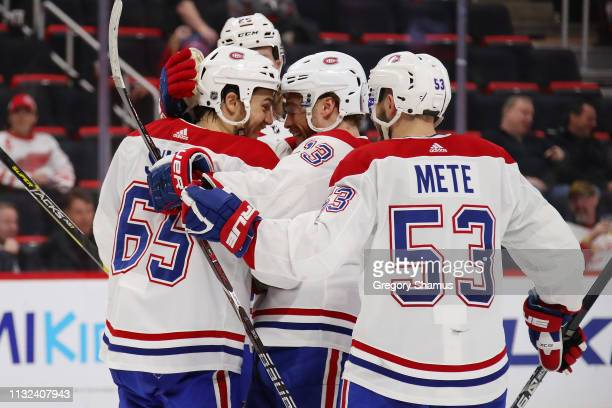 Andrew Shaw of the Montreal Canadiens celebrates his third period goal and hat trick with Max Domi while playing the Detroit Red Wings at Little...