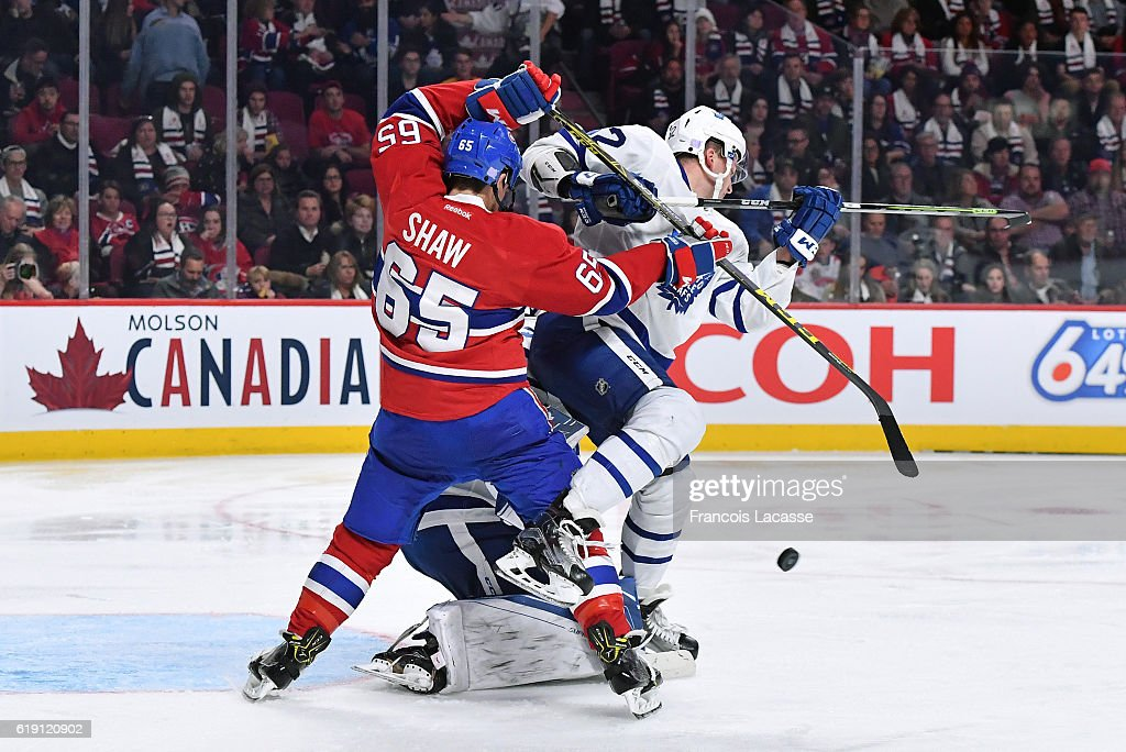 Andrew Shaw #65 of the Montreal Canadiens checks Martin Marincin #52 of the Toronto Maple Leafs in the NHL game at the Bell Centre on October 29, 2016 in Montreal, Quebec, Canada.