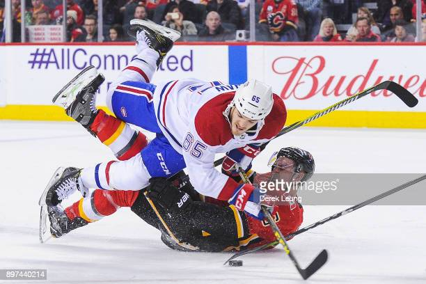 Andrew Shaw of the Montreal Canadiens checks Michael Stone of the Calgary Flames during an NHL game at Scotiabank Saddledome on December 22, 2017 in...