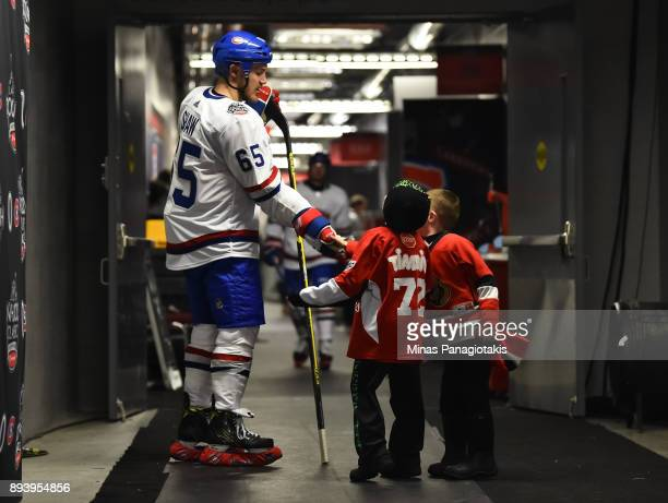 Andrew Shaw of the Montreal Canadiens high fives a Timbits hockey player before heading out for the third period in a game against the Ottawa...