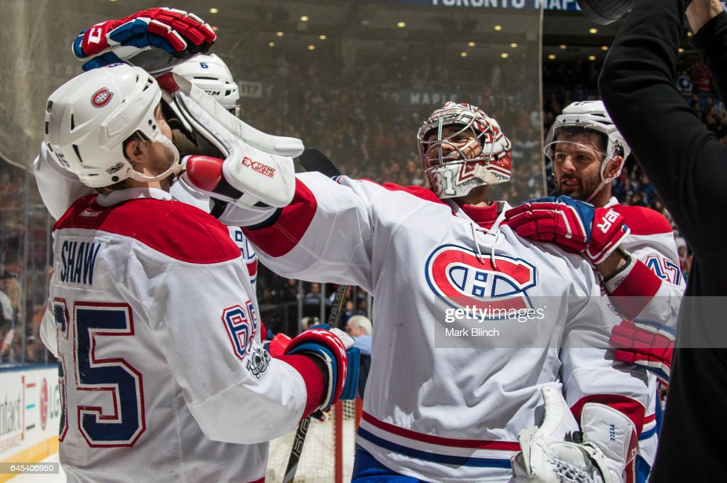 Andrew Shaw #65 of the Montreal Canadiens is congratulated on his game winning overtime goal against the Toronto Maple Leafs by teammate Carey Price #31 at the Air Canada Centre on February 25, 2017 in Toronto, Ontario, Canada.