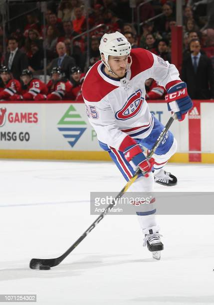 Andrew Shaw of the Montreal Canadiens plays the puck against the New Jersey Devils during the game at Prudential Center on November 21, 2018 in...