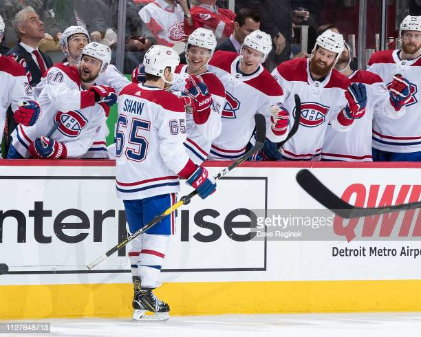 Andrew Shaw of the Montreal Canadiens pounds gloves with teammates on the bench following his second period goal during an NHL game against the...