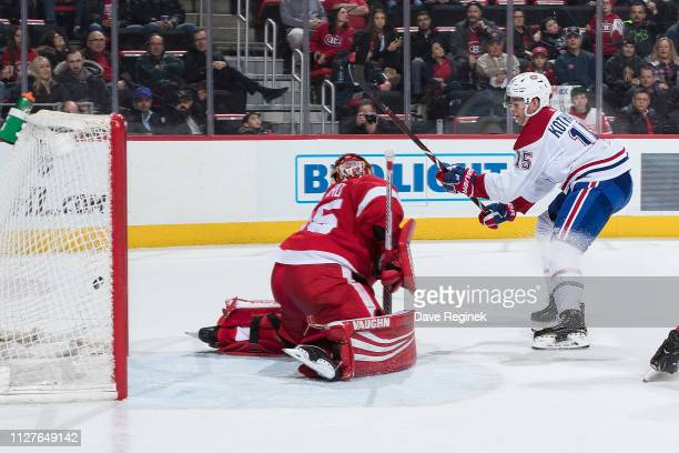 Andrew Shaw of the Montreal Canadiens scores a second goal in the second period as teammate Jesperi Kotkaniemi skates in for the rebound in front of...