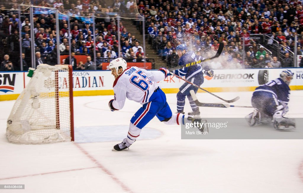 Andrew Shaw #65 of the Montreal Canadiens scores the game winning goal in overtime on Frederik Andersen #31 of the Toronto Maple Leafs at the Air Canada Centre on February 25, 2017 in Toronto, Ontario, Canada.