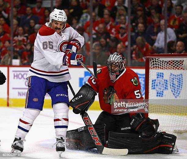 Andrew Shaw of the Montreal Canadiens tries to knock the puck down in front of Corey Crawford of the Chicago Blackhawks at the United Center on...
