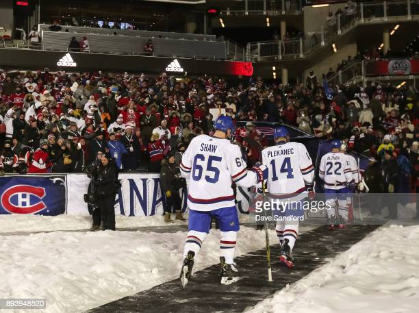 Andrew Shaw Tomas Plekanec and Karl Alzner of the Montreal Canadiens leave the ice at the end of the first period in a game against the Ottawa...