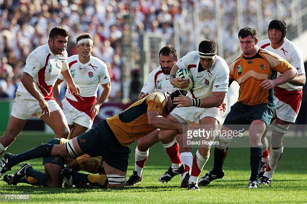 Andrew Sheridan of England is tackled by Daniel Vickerman of Australia during the Quarter Final of the Rugby World Cup 2007 between Australia and...