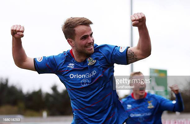 Andrew Shinnie celebrates Billy Mckay of Inverness Caledonian Thistle scoring during the Clydesdale Bank Scottish Premier League match between...