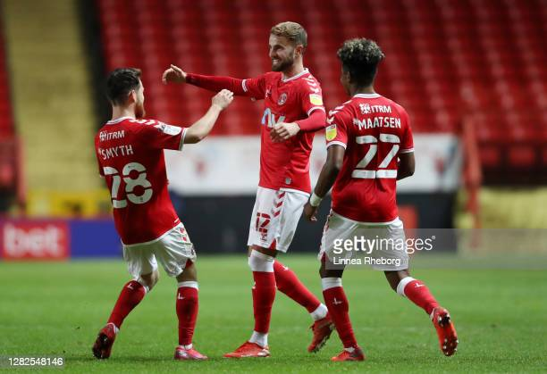 Andrew Shinnie of Charlton Athletic celebrates with Paul Smyth of Charlton Athletic and Ian Maatsen of Charlton Athletic after he scores his team's...
