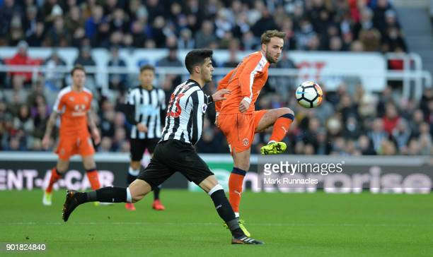 Andrew Shinnie of Luton Town and Mikel Merino of Newcastle United during the The Emirates FA Cup Third Round match between Newcastle United and Luton...