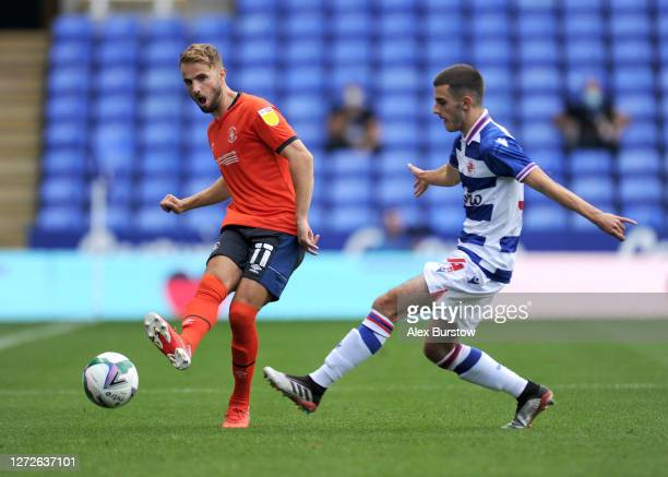 Andrew Shinnie of Luton Town is challenged by Dejan Tetek of Reading FC during Carabao Cup Second Round match between Reading FC and Luton Town at...