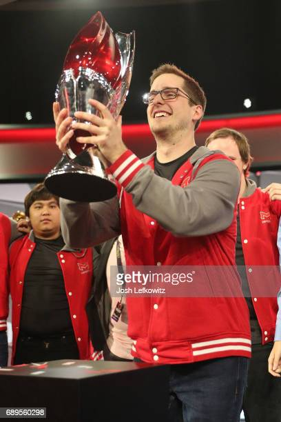 Andrew Smith holds the championship trophy at the League of Legends College Championship between Maryville University and the University of Toronto...