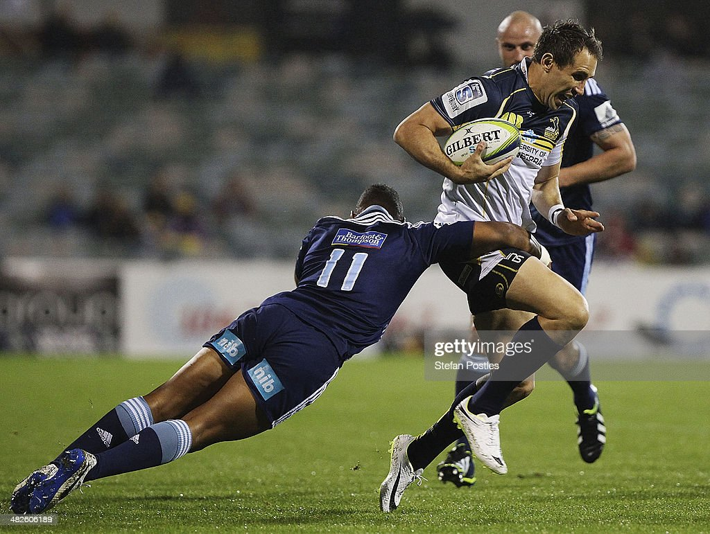 Andrew Smith of the Brumbies is tackled during the round eight Super Rugby match between the Brumbies and the Bulls at Canberra Stadium on April 4, 2014 in Canberra, Australia.