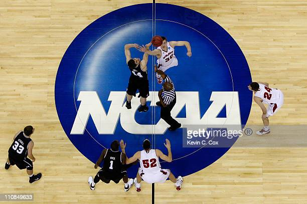 Andrew Smith of the Butler Bulldogs and Jon Leuer of the Wisconsin Badgers tip off to start their game during the Southeast regional of the 2011 NCAA...