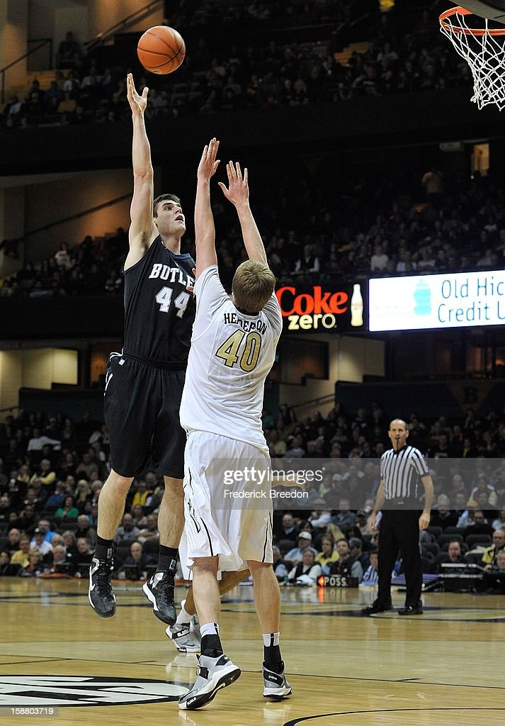 Andrew Smith #44 of the Butler Bulldogs takes a shot over Josh Henderson #40 of the Vanderbilt Commodores at Memorial Gym on December 29, 2012 in Nashville, Tennessee.