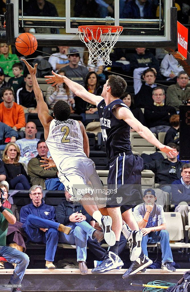 Andrew Smith #44 of the Butler Bulldogs tries to block the shot of Kedren Johnson #2 of the Vanderbilt Commodores at Memorial Gym on December 29, 2012 in Nashville, Tennessee.