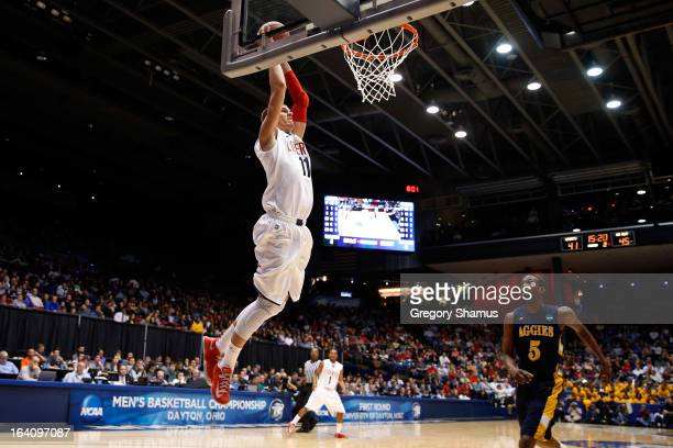 Andrew Smith of the Liberty Flames dunks in the second half against Jean Louisme of the North Carolina AT Aggies during the first round of the 2013...