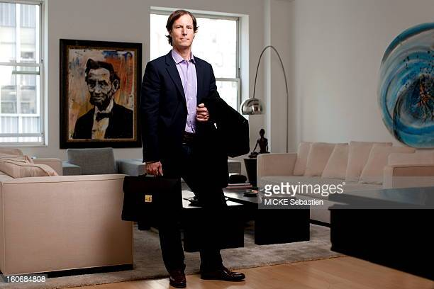 MADOFF Andrew son of Bernard MADOFF posing in the apartment of a friend NEW YORK facing Wall Street his coat over his arm and a bag in hand He told...