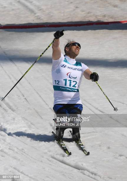 Andrew Soule of the US celebrates his victory after crossing the finish line in the men's 11km sprint sitting crosscountry skiing final event of the...