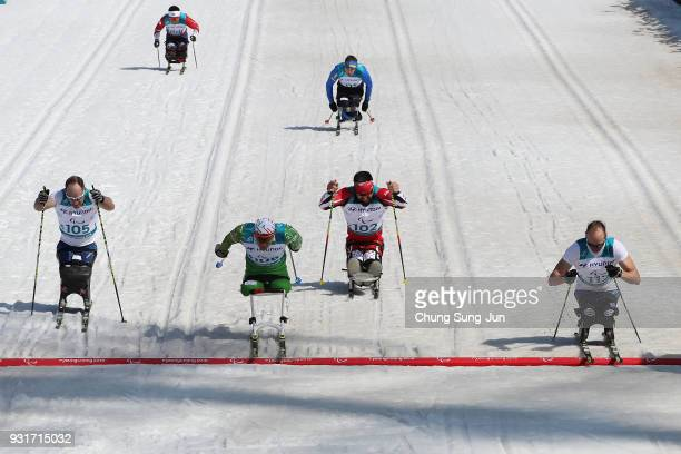 Andrew Soule of United States Dzmitry Loban of Belarus and Daniel Cnossen of United States compete in the CrossCountry Skiing Men's 11km Sprint Final...