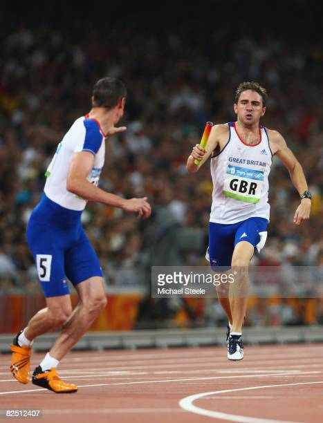 Andrew Steele of Great Britain sprints to Robert Tobin of Great Britain in the Men's 4 x 400m Relay Round 1 Heat 2 at the National Stadium on Day 14...