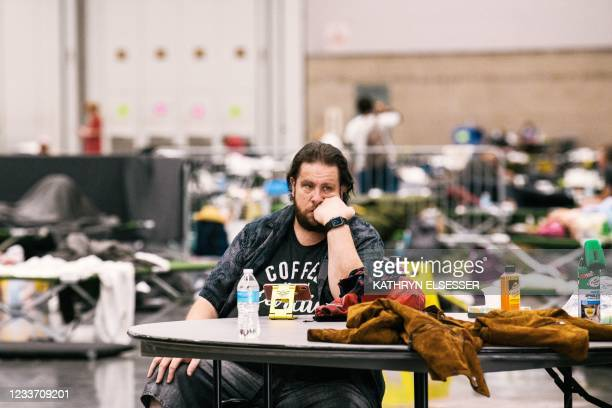 Andrew Steven rests at the Oregon Convention Center cooling station in Oregon, Portland on June 28 as a heatwave moves over much of the United...