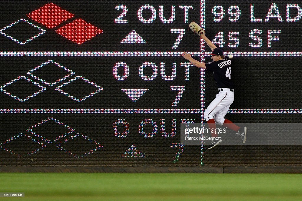 Andrew Stevenson #45 of the Washington Nationals is unable to catch an RBI triple hit by A.J. Pollock #11 of the Arizona Diamondbacks (not pictured) in the sixth inning at Nationals Park on April 27, 2018 in Washington, DC.