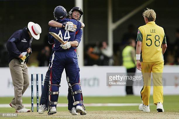 Andrew Strauss and Paul Collingwood of England celebrate victory at the end of the ICC Champions Trophy semi final match between England and...