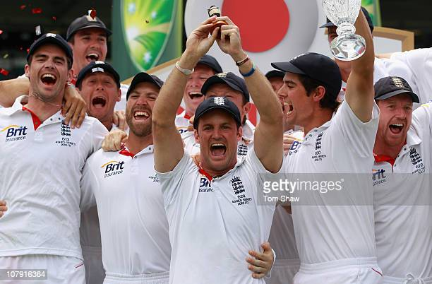Andrew Strauss of England and the rest of the England team pose with the Ashes urn afetr winning the test and the series during day fiveof the Fifth...