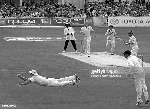 Andrew Strauss of England catches Australian batsman Adam Gilchrist off Andrew Flintoff during the 4th Test match between England and Australia at...