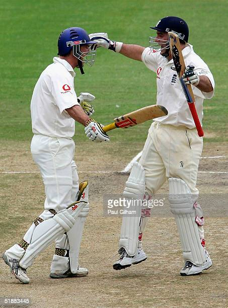 Andrew Strauss of England celebrates with Graham Thorpe after scoring the winning runs to give England victory during day five of the first Test...