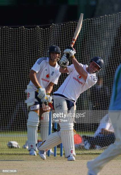 Andrew Strauss of England has a bat in the nets as Alastair Cook of England looks on during the England nets session at the Sheikh Zayed Stadium on...