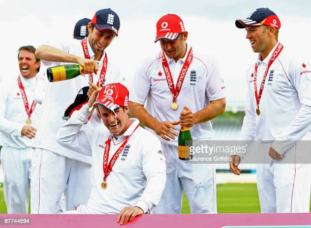 Andrew Strauss of England has champagne poured over his head by Graham Onions during day five of the npower Test Match between England and The West...