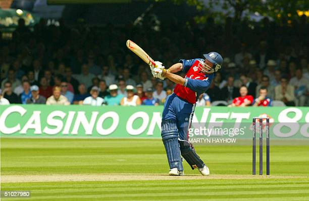 Andrew Strauss of England hits out during his innings of 100 runs in the NatWest Series oneday international againt the West Indies at Lord's in...