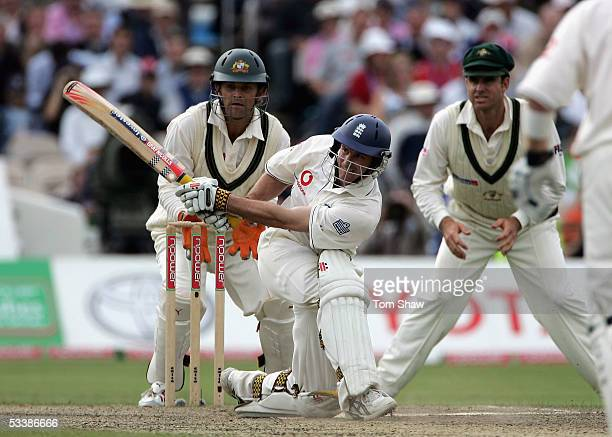 Andrew Strauss of England hits out watched by wicketkeeper Adam Gilchrist and Matthew Hayden of Australia during day four of the Third npower Ashes...
