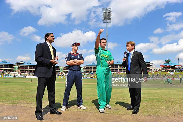 Andrew Strauss of England looks on as Graeme Smith of South Africa tosses the coin with match referee Javragal Srinath and commentator Neil Manthorp...