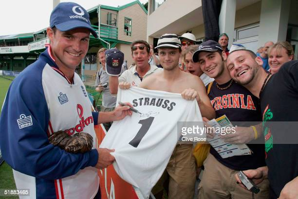 Andrew Strauss of England signs shirts for the 'Barmy Army' after England win the first Test Match between South Africa and England at StGeorges Park...