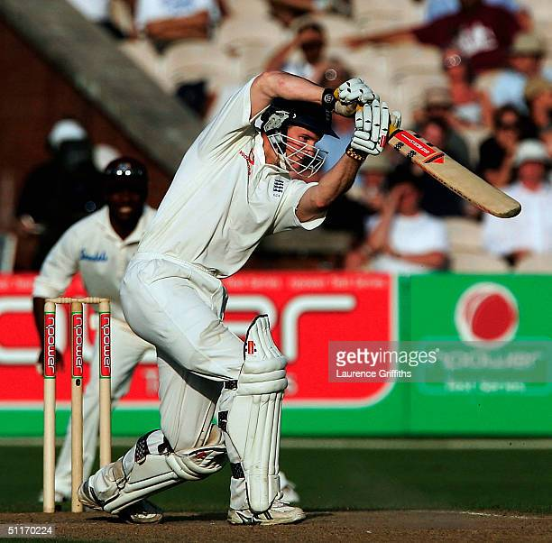 Andrew Strauss of England smashes the ball through the covers during day three of the England v West Indies Third npower Test Match at Old Trafford...