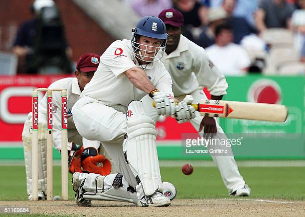 Andrew Strauss of England sweeps to the boundary during day three of the England v West Indies Third npower Test Match at Old Trafford on August 14...