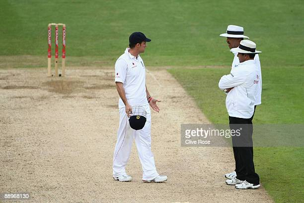 Andrew Strauss of England talks to match Umpires Billy Doctrove and Allem Dar after the light is taken by Australia during day three of the npower...