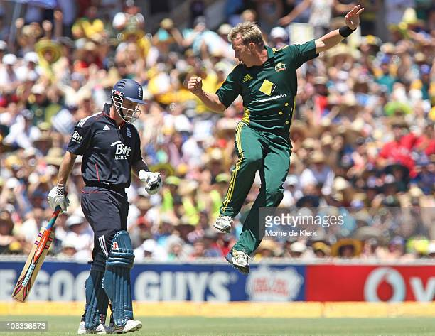Andrew Strauss of England walks off as Brett Lee of Australia skips past him to celebrate getting him out during game four of the Commonwealth Bank...