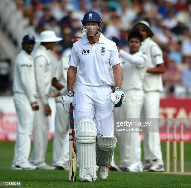 Andrew Strauss of England walks to the pavilion as he is caught off the bowling of Sreesanth of India for 16 runs during the second npower Test match...