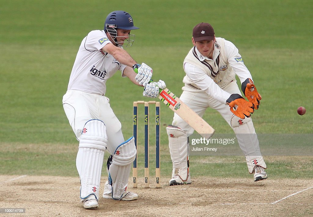 Andrew Strauss of Middlesex in action as Gary Wilson of Surrey watches on during day four of the LV= County Championship Division Two match between Surrey and Middlesex at The Brit Oval on May 20, 2010 in London, England.