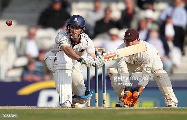 Andrew Strauss of Middlesex in action as wicket keeper, Gary Wilson of Surrey watches on during day two of the LV= County Championship match between...