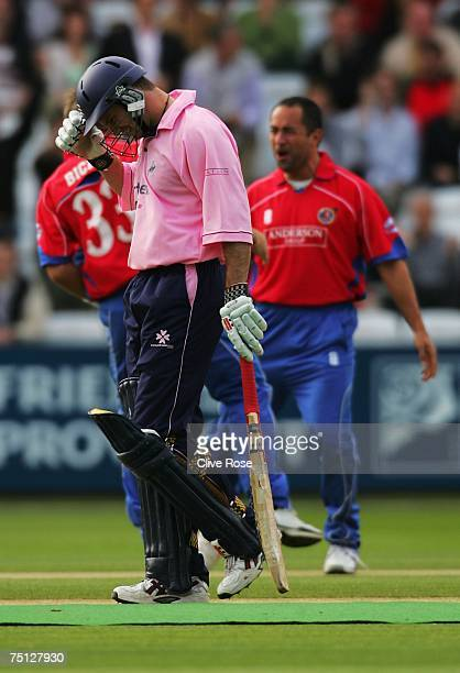 Andrew Strauss of Middlesex walks off after being caught by Adam Hollioake of Essex during the Twenty20 Cup match between Middlesex and Essex at...