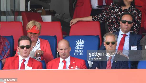 Andrew Strauss pictured in his red suit with England captain Eoin Morgan and selector Ed Smith during Ruth Strauss Foundation day during Day two of...
